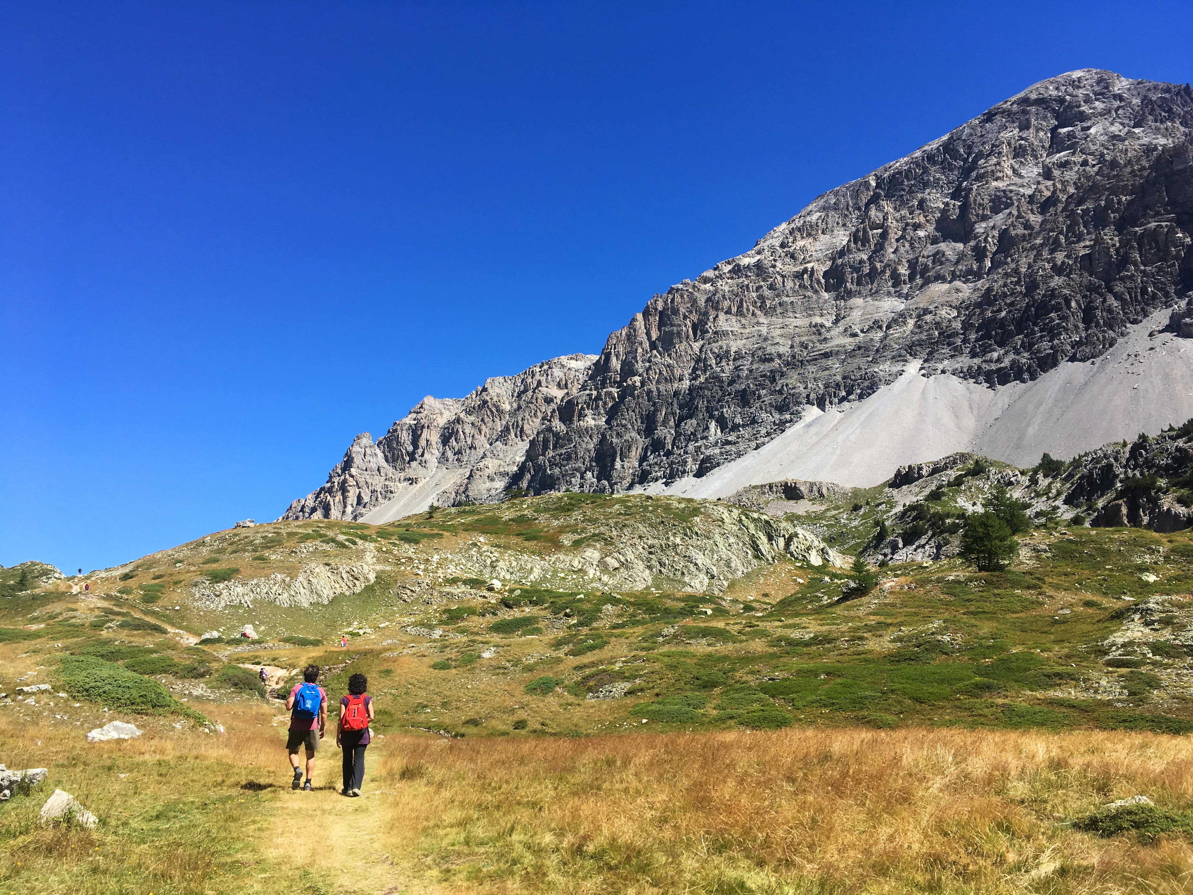 Couple walking towards the mountain